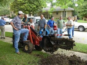 a trenching party held to install a new sprinkler system in Dallas