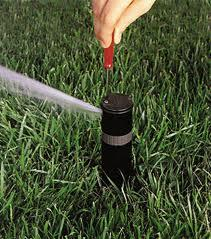 an irrigation repair in University Park specialist is making a seasonal adjustment